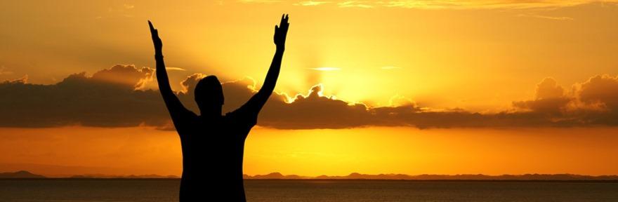 Prayer - silhouette of man with raised arms